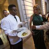 A waiter carries plates of food during dinner service at the 91st Season Opening Night Gala of the San Francisco Opera at War Memorial Opera House in San Francisco, Calif. on Friday, Sept. 6, 2013.