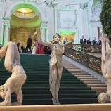 Performers strike poses in an exotic display on the grand staircase of the City Hall rotunda, in keeping with the slightly eerie theme of the event.
