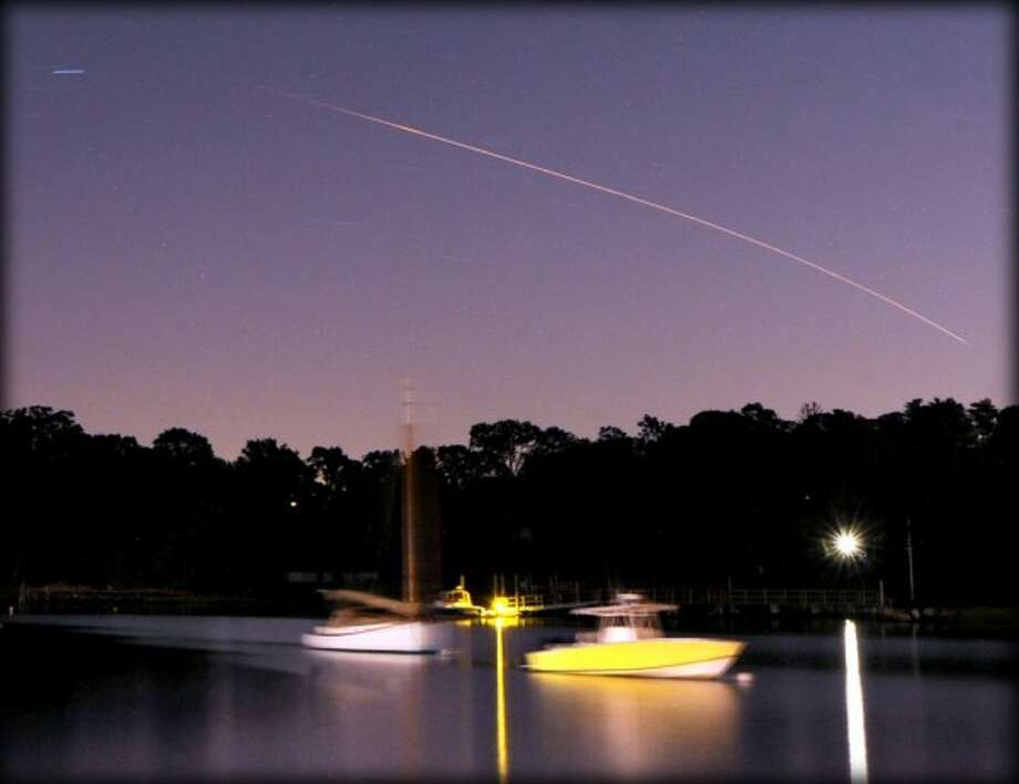 A NASA rocket carrying the Lunar Atmosphere and Dust Environmental Explorer, otherwise known as LADEE, is seen headed for the moon streaking across the night sky over Greenwich Harbor, 11:28 p.m. Friday, Sept. 6, 2013. The Minotaur rocket, launched from Virginia, and visible in the sky from South Carolina to Maine, carried a spacecraft that will conduct a 100 day mission to measure lunar dust and examine the lunar atmosphere from an orbit of 40 miles above the surface of the moon. For more information on this first-ever moonshot from the State of Virginia, please see the blog post of my colleague, Jim Shay.