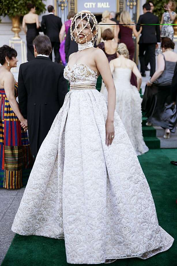 Deepa Pakianathan peeks out from her custom Alexander McQueen 'cage' in her Andrew Gn gown as she arrives to the 91st San Francisco Season-Opening Opera Gala in San Francisco Calif. on Friday, Sept. 6, 2013.  Pakianathan said her head piece only arrived the morning of the event and she was worried she wouldn't receive it in time. Photo: Alex Washburn, Special To The Chronicle