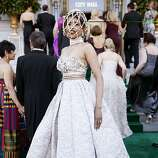 Deepa Pakianathan peeks out from her custom Alexander McQueen 'cage' in her Andrew Gn gown as she arrives to the 91st San Francisco Season-Opening Opera Gala in San Francisco Calif. on Friday, Sept. 6, 2013.  Pakianathan said her head piece only arrived the morning of the event and she was worried she wouldn't receive it in time.