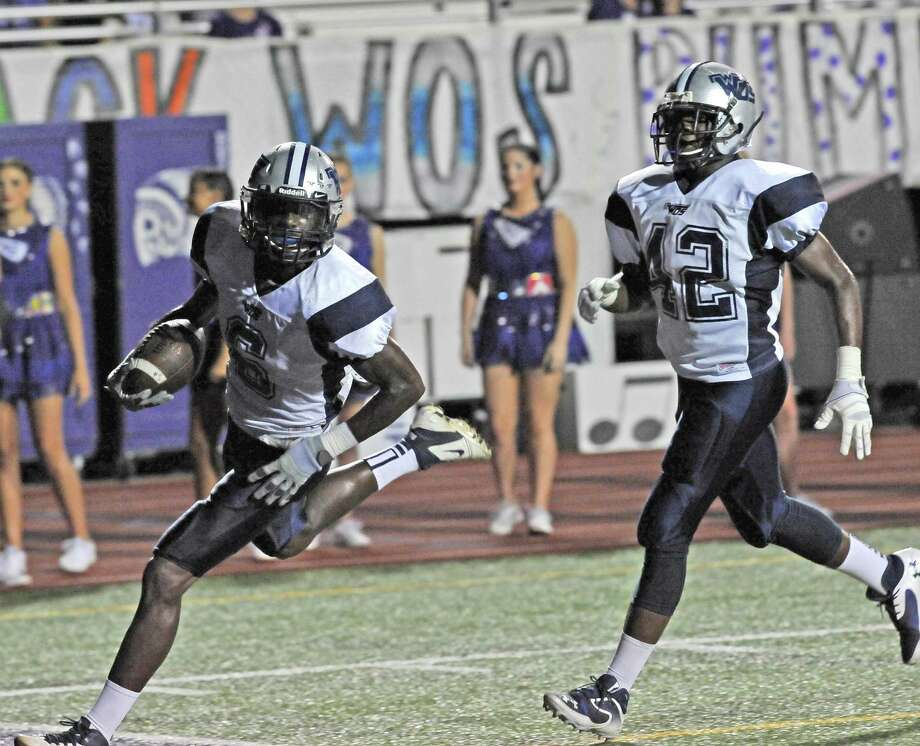 Mustang #6, Deionte Thompson, left, scores a Mustang touchdown in first half action. The Port Neches-Groves Indians hosted the West Orange-Stark Mustangs Friday night at the Reservation. Dave Ryan/The Enterprise Photo: Dave Ryan