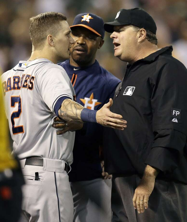 Sept. 6: A's 7, Astros 5 Brandon Barnes, left, is restrained by manager Bo Porter, center, as he argues his ejection with third base umpire Jerry Layne. Photo: Ben Margot, Associated Press