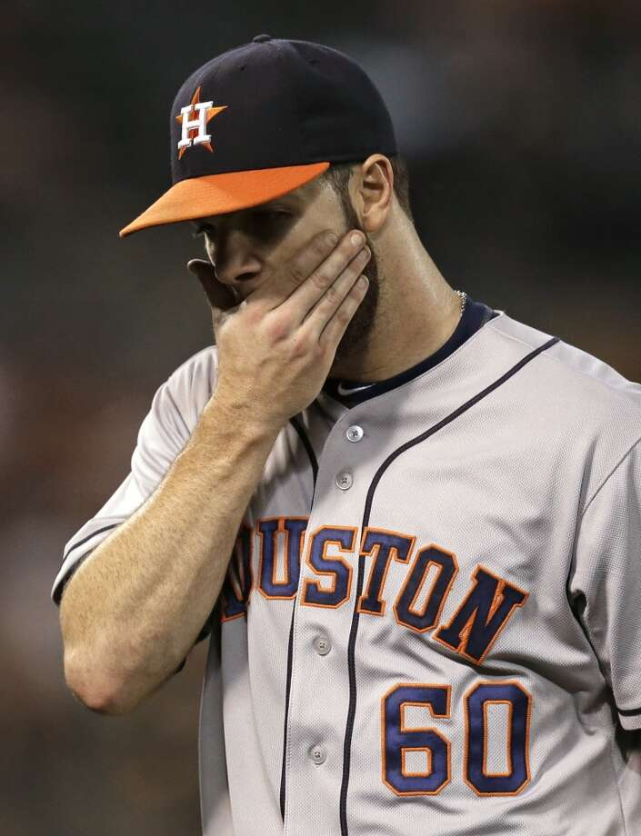 Dallas Keuchel wipes his face after being removed from the game. Photo: Ben Margot, Associated Press