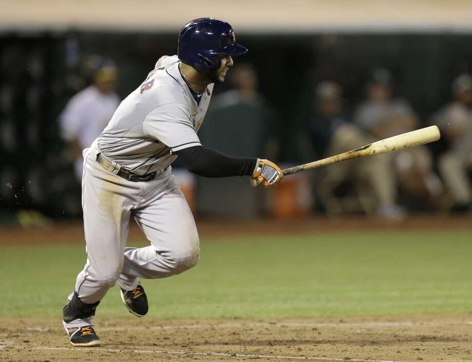 Jonathan Villar runs after hitting an RBI bunt-single. Photo: Ben Margot, Associated Press