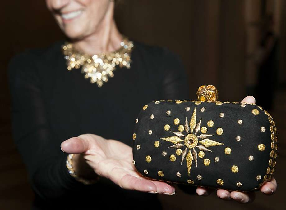 Nancy Bechtle holds up her Alexander McQueen clutch at the 91st San Francisco Season-Opening Opera Gala in San Francisco Calif. on Friday, Sept. 6, 2013.  The theme of the decor for the night was 'The Garden of Good and Evil'. Photo: Alex Washburn, Special To The Chronicle