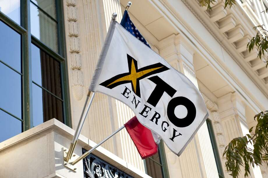 1. $41.4 billion  In December 2009, Exxon Mobil announced plans to buy Fort Worth, Texas-based XTO Energy in a stock deal, making a major bet on the future of natural gas. Exxon Mobil is now the largest producer of natural gas in North America.  [photo: A flag flies otuside the headquarters building of XTO Energy Inc. in Fort Worth, Texas, U.S., on Monday, Dec. 14, 2009.] Photo: Matt Nager, Bloomberg