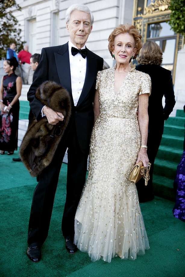 Robert Girard (in Armani) and Pheobe Cowles in a gold Oscar de la Renta gown arrive at the 91st San Francisco Season-Opening Opera Gala in San Francisco Calif. on Friday, Sept. 6, 2013. Photo: Alex Washburn, Special To The Chronicle