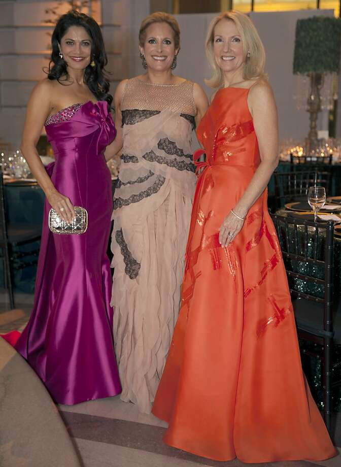 Opera Ball co-chairwoman Mai Sharif Shiver (left) in a Luly Yang Couture 'Cosmopolitan' gown stands with Lorre Erlick (center) in Valentino and fellow co-chairwoman Anne Girard (in Angel Sanchez)inside City Hall as the 91st San Francisco Season-Opening Opera Gala begins on Friday, Sept. 6, 2013. Photo: Alex Washburn, Special To The Chronicle