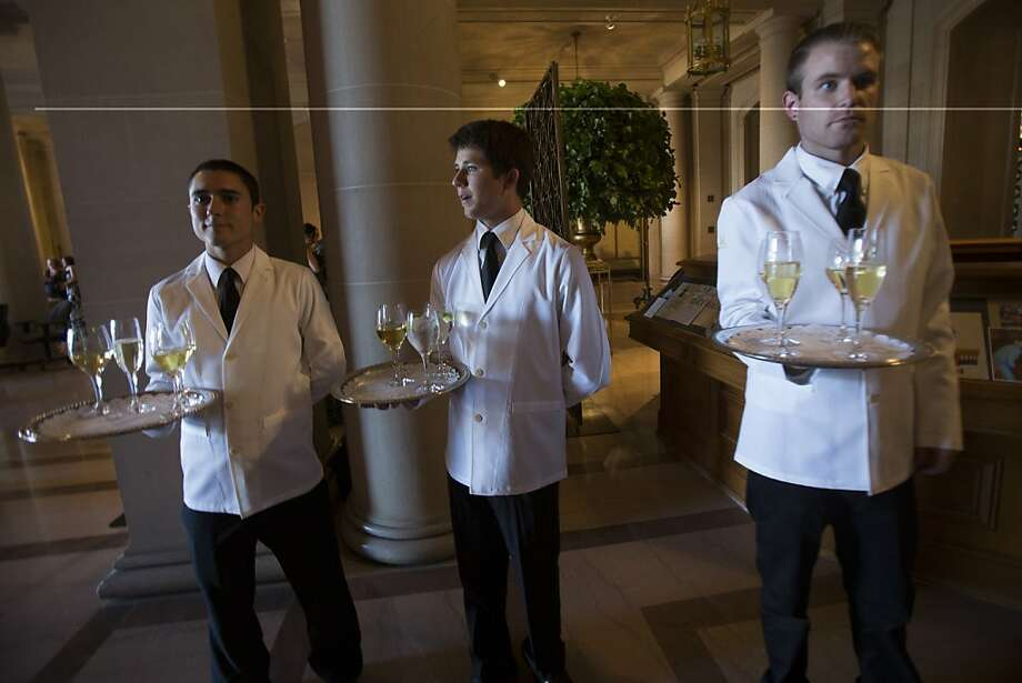 (L-R) Waiters Felix Sandoval, Claye Fowler, and Ryan Bollier carry trays of champagne at the 91st Season Opening Night Gala of the San Francisco Opera at City Hall in San Francisco, Calif. on Friday, Sept. 6, 2013. Photo: Stephen Lam, Special To The Chronicle