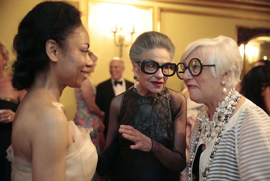 Tanya Powell (left), Joy Bianchi (center) and Suzanne Allen (right) talk during the second intermission of the 91st San Francisco Season-Opening Opera Gala performance in San Francisco Calif. on Friday, Sept. 6, 2013.  Powell wore Vera Wang to the event, Bianchi dressed in Ralph Rucci and Allen wore vintage Courreges. Photo: Alex Washburn, Special To The Chronicle