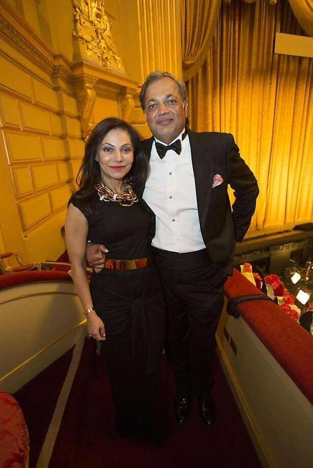 Dr. Isha Abdullah, left, in an Emanuel Ungaro dress, and husband Asim Abdullah stand for a photo during the 91st Season Opening Night of the San Francisco Opera at War Memorial Opera House in San Francisco, Calif. on Friday, Sept. 6, 2013. Photo: Stephen Lam, Special To The Chronicle