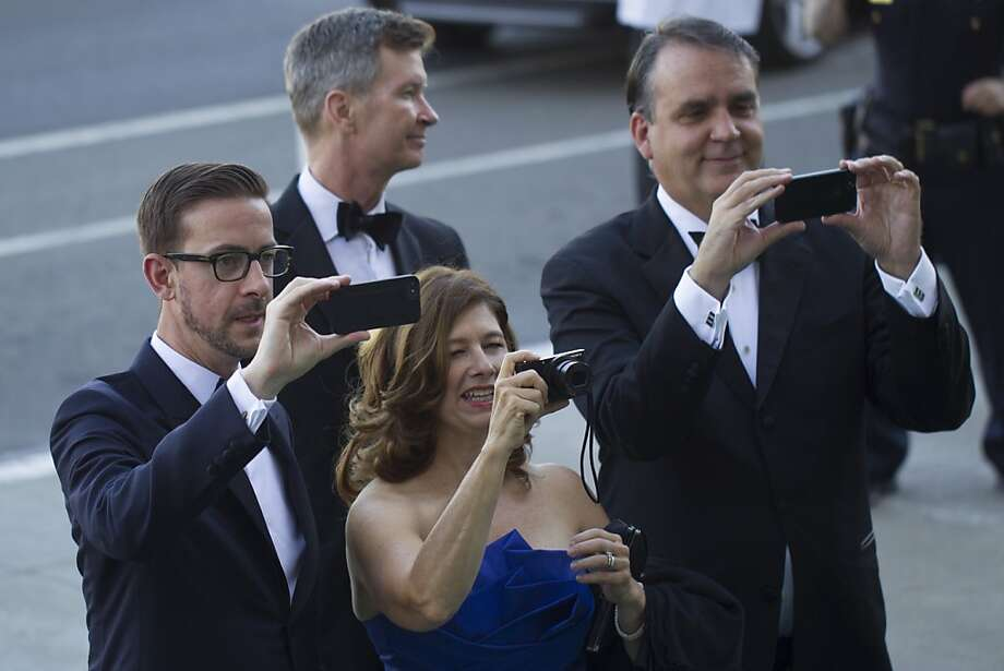 (L-R) Christopher Koelsch, Holly Nuckols, and John Nuckols take photographs of friends during the 91st Season Opening Night Gala of the San Francisco Opera at City Hall in San Francisco, Calif. on Friday, Sept. 6, 2013. Photo: Stephen Lam, Special To The Chronicle