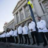 Valet drivers wait outside City Hall during the 91st Season Opening Night Gala of the San Francisco Opera in San Francisco, Calif. on Friday, Sept. 6, 2013.