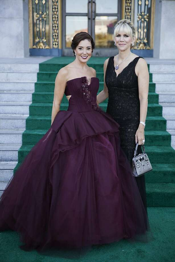 Marybeth LaMotte in Vera Wang (left) and Kimberlee Sharp Dutto in Monique Lhuillier (right) on the steps of City Hall after arriving to the 91st San Francisco Season-Opening Opera Gala in San Francisco Calif. on Friday, Sept. 6, 2013. Photo: Alex Washburn, Special To The Chronicle