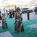 Fati Farmanfarmaian in a gown by Gucci walks up the steps of City Hall during the 91st Season Opening Night Gala of the San Francisco Opera in San Francisco, Calif. on Friday, Sept. 6, 2013.