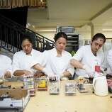 Kitchen staff assemble chocolate skull desserts during the 91st Season Opening Night Gala of the San Francisco Opera at City Hall in San Francisco, Calif. on Friday, Sept. 6, 2013.