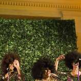Three singers dance and sing on a stage during the after party of the 91st Season Opening Night of the San Francisco Opera at City Hall in San Francisco, Calif. on Saturday, Sept. 7, 2013.