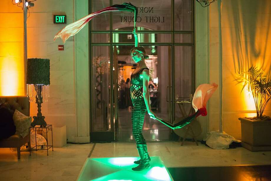 A performer dances on a platform during the after party of the 91st Season Opening Night of the San Francisco Opera at City Hall in San Francisco, Calif. on Saturday, Sept. 7, 2013. Photo: Stephen Lam, Special To The Chronicle