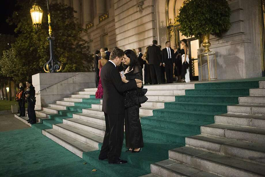Ragnar Kruse, left, embraces Petra Vorsteher after attending San Francisco Opera's 91st Season Opening Night after party at City Hall in San Francisco, Calif. on Saturday, Sept. 7, 2013. Photo: Stephen Lam, Special To The Chronicle