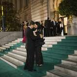 Ragnar Kruse (left) embraces Petra Vorsteher on the carpeted staircase outside.