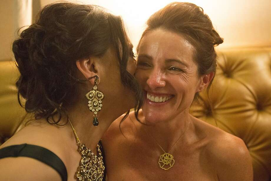 Bilques Smith kisses Anne Laury during San Francisco Opera's 91st Season Opening Night after party at City Hall in San Francisco, Calif. on Saturday, Sept. 7, 2013. Photo: Stephen Lam, Special To The Chronicle