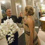 Patrick Gabrielli high fives Lorre Erlick as they prepare to leave San Francisco Opera's 91st Season Opening Night after party at City Hall in San Francisco, Calif. on Saturday, Sept. 7, 2013.