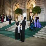 Rick and Donna Matcovich waits for their car after attending San Francisco Opera's 91st Season Opening Night after party at City Hall in San Francisco, Calif. on Saturday, Sept. 7, 2013.