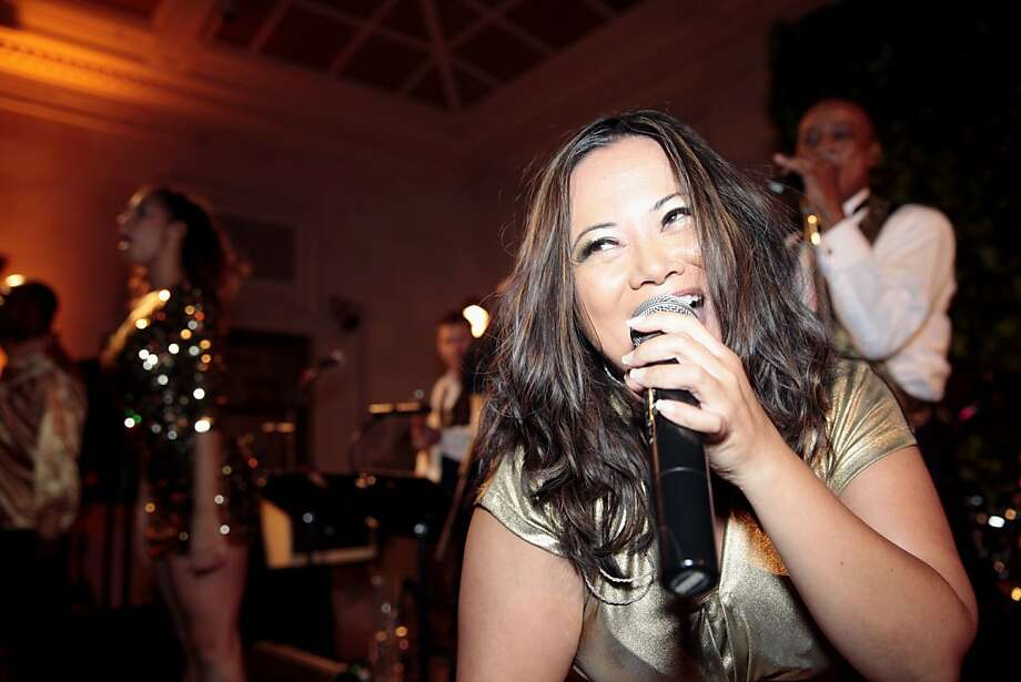 April Kee belts out the last song of the night with her group the Bill Hopkins Rock'n Orchestra during the after party of the 91st San Francisco Season-Opening Opera Gala in San Francisco Calif. on Friday, Sept. 6, 2013. Photo: Alex Washburn, Special To The Chronicle