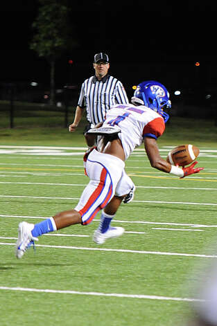 West Brook's Charles Ward, 4, tips the ball for a reception and run for the first West Brook touch down against Central's at the Carroll Thomas Stadium Friday night. Photo provided by Drew Loker. Photo: Drew Loker / 2013