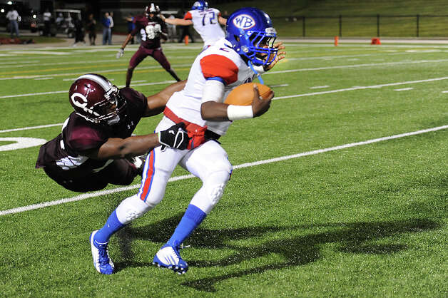 West Brook's Isaac Aubrey, 2, runs the ball for a short gain while Central's Derek Broussard, 14, attempts to drag him down at the Carroll Thomas Stadium Friday night. Photo provided by Drew Loker. Photo: Drew Loker / 2013