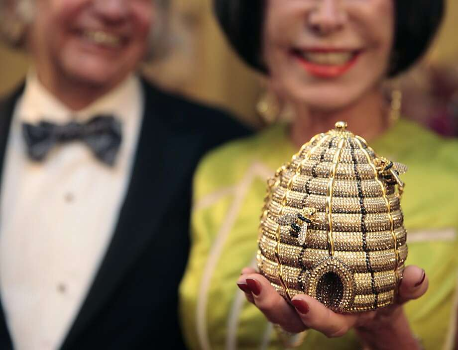 Marilyn Cabak holds up her Judith Leiber beehive clutch during intermission of the 91st San Francisco Season-Opening Opera Gala in San Francisco Calif. on Friday, Sept. 6, 2013. Photo: Alex Washburn, Special To The Chronicle