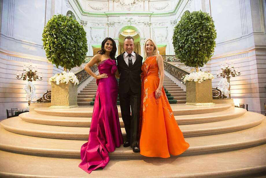 San Francisco Opera Guild Co-Chair Mai Shiver, left, in Luly Yang, and Ann Girard, in Angel Sanchez, stand for a photo with New York celebrity event planner Colin Cowie, middle, during the 91st Season Opening Night Gala of the San Francisco Opera at City Hall in San Francisco, Calif. on Friday, Sept. 6, 2013. Photo: Stephen Lam, Special To The Chronicle