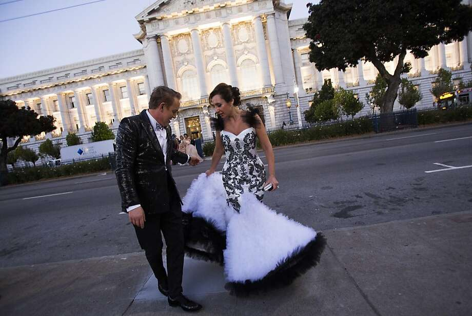 Joel Goodrich, left, and Clara Shayevich, share a smile as they walk from City Hall to attend the 91st Season Opening Night of the San Francisco Opera at War Memorial Opera House in San Francisco, Calif. on Friday, Sept. 6, 2013. Photo: Stephen Lam, Special To The Chronicle