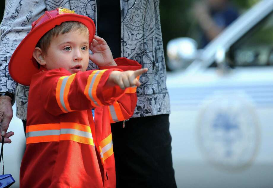 Five-year-old Cody LaFrancois, of Milford, watches the trucks roll by on North Street to kick off the 42nd Annual Engine 260 Antique Fire Apparatus Show & Muster at Eisenhower Park in Milford, Conn. Saturday, Sept. 7, 2013. Photo: Autumn Driscoll / Connecticut Post