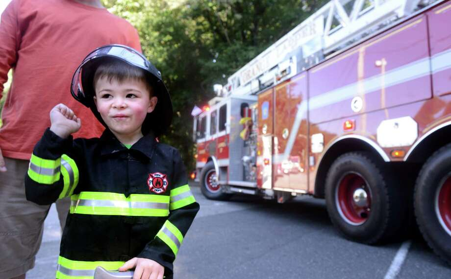 Four-year-old Nathan Barbee, of Stratford, signals for the trucks to blow their horns as they roll past on North Street to kick off the 42nd Annual Engine 260 Antique Fire Apparatus Show & Muster at Eisenhower Park in Milford, Conn. Saturday, Sept. 7, 2013. Photo: Autumn Driscoll / Connecticut Post
