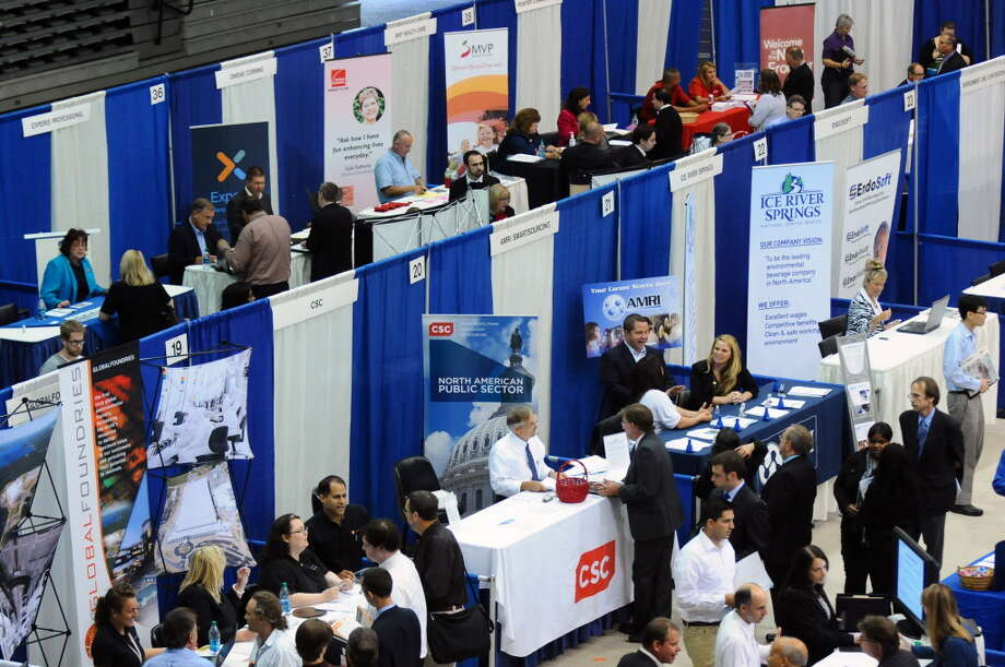 Vendors speaks to attendees of the Tech Career Expo at the SEFCU Arena at UAlbany on Monday Sept. 10, 2012 in Albany, NY.    (Philip Kamrass / Times Union) Photo: Philip Kamrass / 00019193A