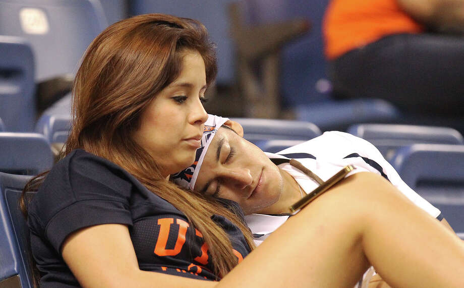 UTSA fans take a break from cheering during the game against Oklahoma State in the second half at the Alamodome on Saturday, Sept. 7, 2013. OSU defeated UTSA, 56-35. Photo: Kin Man Hui, San Antonio Express-News / ©2013 San Antonio Express-News
