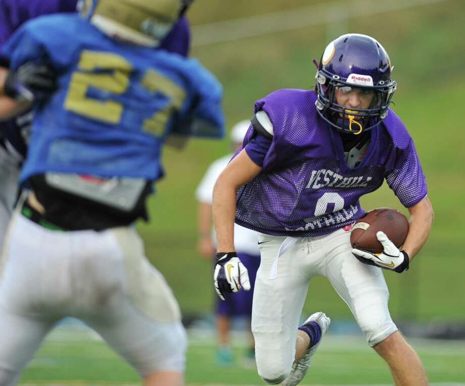 Westhill receiver Dante Fargnoli runs after a catch in the high school football scrimmage between Newtown and Westhill at Newtown High School in Newtown, Conn. on Wednesday, Aug. 28, 2013. Photo: Tyler Sizemore / The News-Times