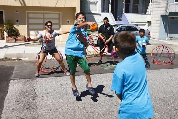 Gloria Sagastume (left), Alejandro Jimenez and Christopher Carcamo play as Javier Guzman and Carlos Martinez look on. Photo: Raphael Kluzniok, The Chronicle
