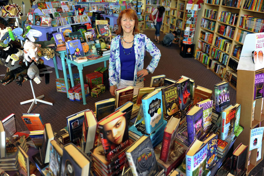 Linda Devlin poses at her bookstore: Linda's Story Time in Monroe, Conn. on Saturday September 7, 2013. Linda's Story Time is a full service, independent book store which features children's books from ages 0-18 and offer a newly expanded adult section. Photo: Christian Abraham / Connecticut Post