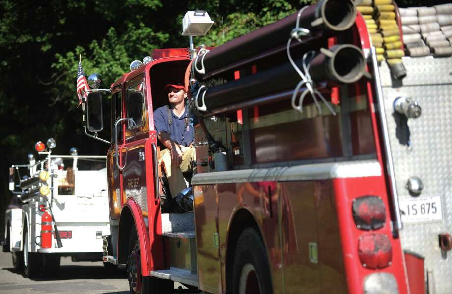 The 42nd Annual Engine 260 Antique Fire Apparatus Show & Muster at Eisenhower Park in Milford, Conn. Saturday, Sept. 7, 2013. Photo: Autumn Driscoll / Connecticut Post