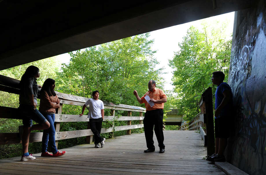 Randy Cotto, Director of the Pathfinders Club at Spanish Orion Seventh-day Adventist Church in Bridgeport, teachs several youths in the club about nature with emphasis on God and creation, during a nature hike at Old Mine Park in Trumbull, Conn. on Saturday September 7, 2013. The Pathfinders Club is an international club for youth sponsored by the Seventh-day Adventist Church and in Connecticut, Massachussetts, and Rhode Island there are 45 clubs with over 1200 members. Members from left to right are Kimberly Lopez, 13, Lisette Sanchez, 16, Jorge Landivar, 12, Cotto, and Eduardo Mena, 12. There were about 30 kids who came to the park and broke up into small groups with other instructors to learn about nature, the environment, good stewardship of it, and other topics with a spiritual theme. For more information about the Pathfinders organization: http://www.pathfindersonline.org/ Photo: Christian Abraham / Connecticut Post