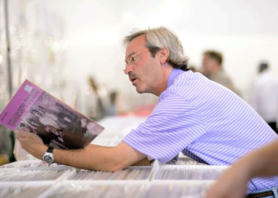 Robert Cooper, of Stratford, looks for vinyl records at MUSIC MASH 2013, a record fair and sale hosted by WPKN, Saturday, Sept. 7, 2013 at Fairfield Theatre Company Annex in Fairfield, Conn. The first annual sale featured 50 record vendors selling LPs, CDs and memorabilia as well as four food trucks and a vintage clothing sale and attracted over 500 music enthusiasts. Photo: Autumn Driscoll / Connecticut Post