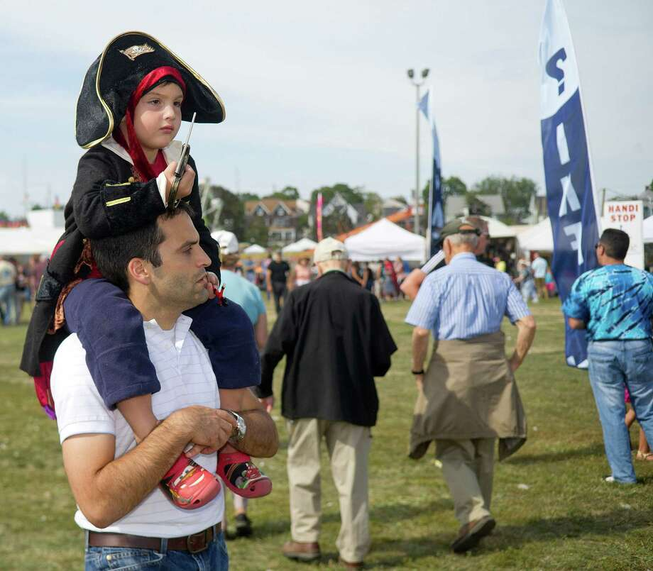 Michael Bria, 4, gets a ride from his dad, Frank, during the Norwalk Seaport Association's 37th annual oyster festival on Saturday, September 7, 2013. Photo: Lindsay Perry / Stamford Advocate