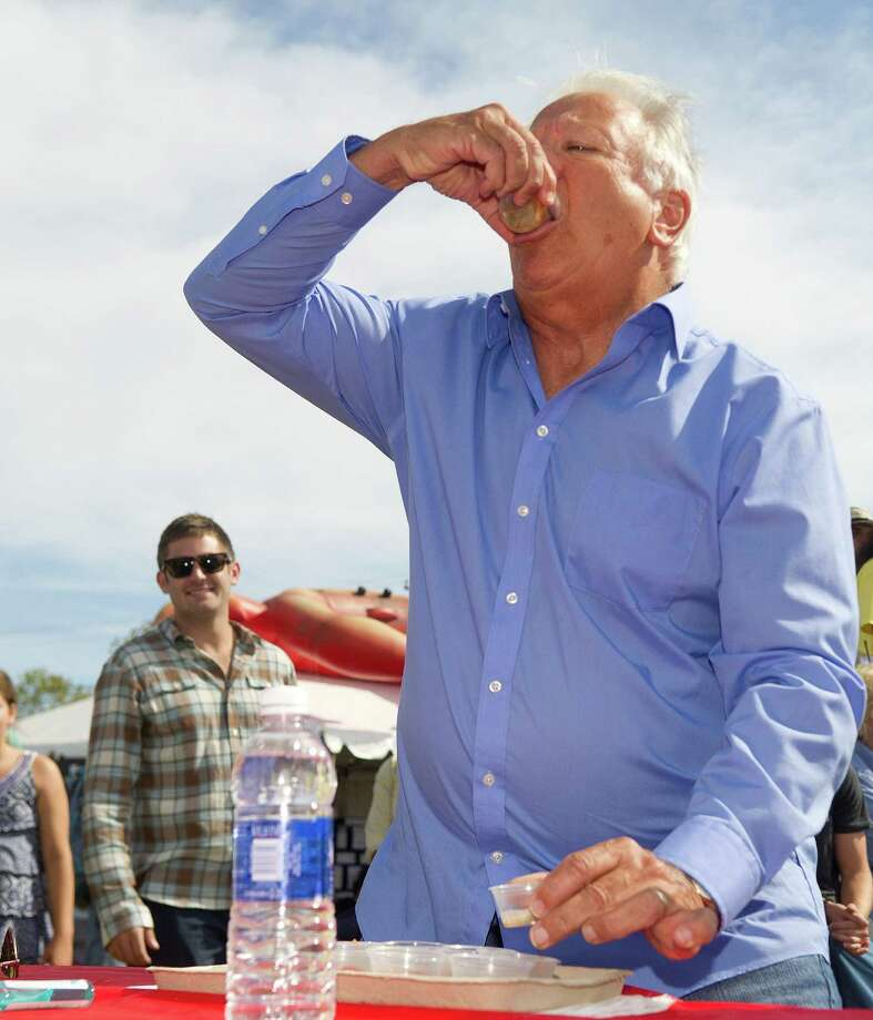 Norwalk Mayor Richard Moccia competes in the Celebrity Slurp-off oyster-eating contest during the Norwalk Seaport Association's 37th annual oyster festival on Saturday, September 7, 2013. Photo: Lindsay Perry / Stamford Advocate