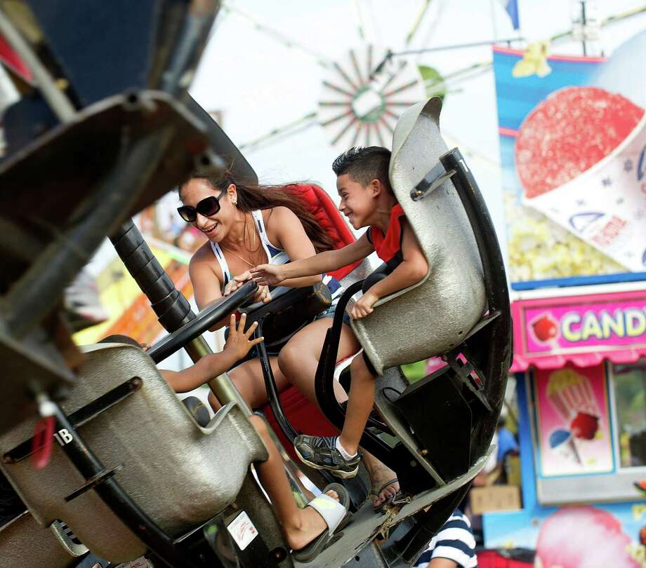 Kelly Gonzales and Jayce Gonzales, 6, ride Tornado during the Norwalk Seaport Association's 37th annual oyster festival on Saturday, September 7, 2013. Photo: Lindsay Perry / Stamford Advocate