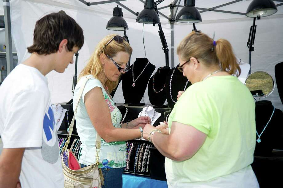 Festival attendees shop during the Norwalk Seaport Association's 37th annual oyster festival on Saturday, September 7, 2013. Photo: Lindsay Perry / Stamford Advocate