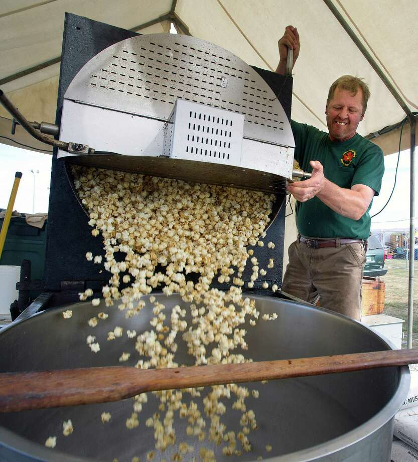 Don Bureau of Bureau's Sugarhouse Maple Kettlecorn empties cooked corn to be packaged during the Norwalk Seaport Association's 37th annual oyster festival on Saturday, September 7, 2013. Photo: Lindsay Perry / Stamford Advocate