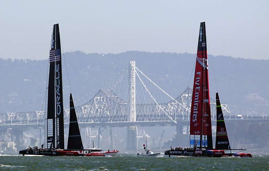 Oracle Team USA chases Team New Zealand toward the third marker during the first of two America's Cup finals races. Photo: Beck Diefenbach, Special To The Chronicle